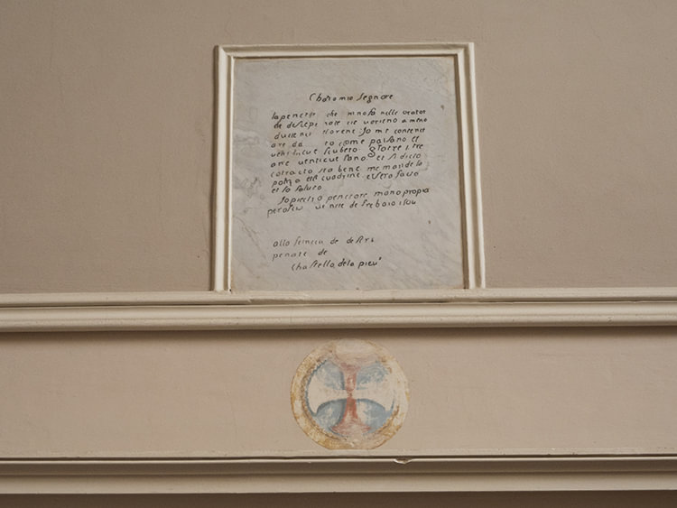 One of Pietro Perugino's letters transferred into the wall.